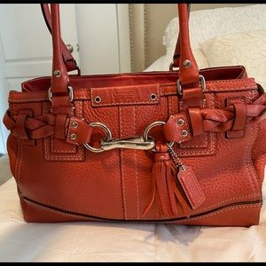 Beautiful preowned coral coach handbag.